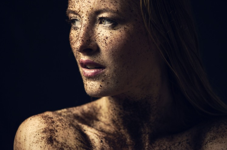 young-women-face-portrait-covered-in-dirt